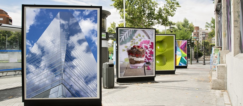 4 billboards with photographs exhibited at city street
